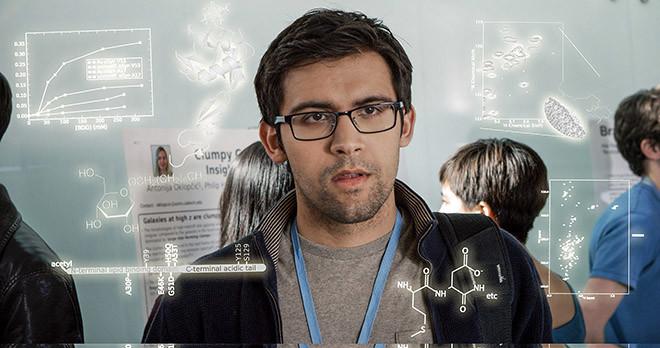 Den Namnlöse Doktoranden (spelad av doktoranden Raj Katti) våndas över sin första konferenspresentation i filmen PHD Movie 2.
